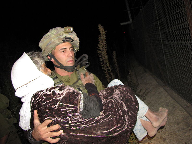 Help in Hebrew: Archived picture of Israeli Soldier Helping a Lebanese Woman