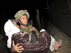 Help in Hebrew with Israel News: Archived picture of Israeli Soldier Helping a Lebanese Woman